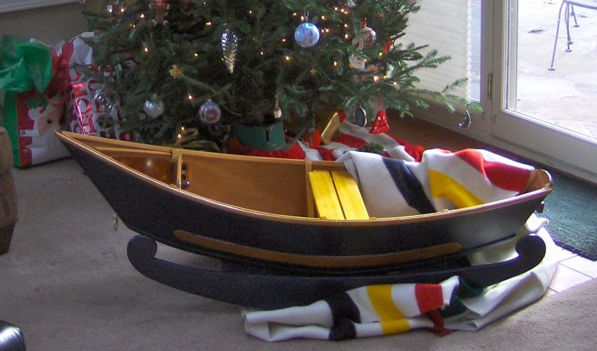Designed and built by veteran boat builders Gregg Hatten and Roger Fletcher, this handcrafted wooden rocking boat is a replica of the historic McKenzie Style Drift Boats that run the Big Water Rivers of the Pacific Northwest. (Does this little boat seem familiar? Maybe thats because it's a 1/3 scale version of Portola featured on the cover of Epoxyworks 35.)