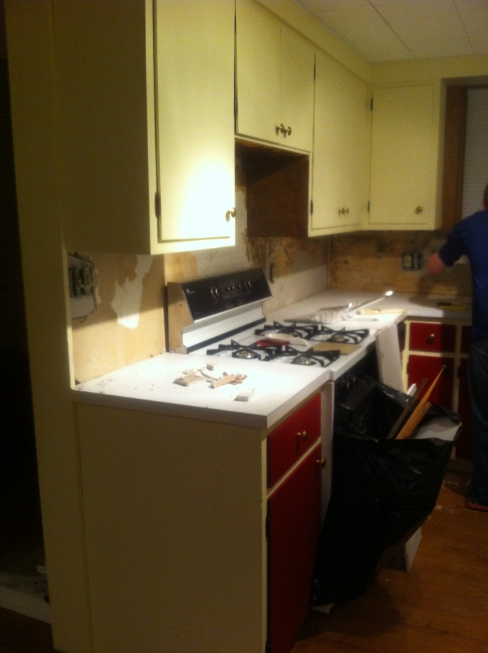 The kitchen before the renovation. The cabinet doors were painted cream on the top and red on the bottom.