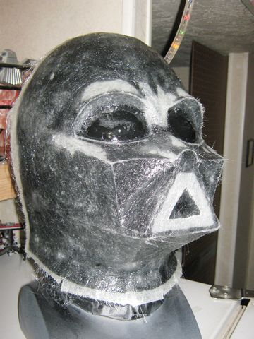 The Darth Vadar cosplay helmet mold with the fiberglass pieces applied
