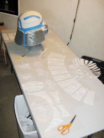 Fiberglass pieces cut to size and laid out, ready for application