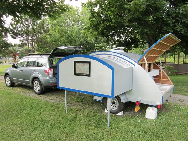 The teardrop trailer set up with the slide-out extended.