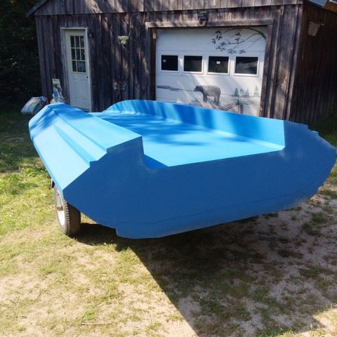 The tunnel hull repaired, and faired with WEST SYSTEM Epoxy thickened with high-density and low-density fillers, then gel coated in blue. We had no problems using the poly-based gel coat over epoxy, as we took no shortcuts. Everything was sanded and properly cleaned before spraying.