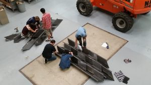 students assemble columns
