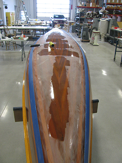 Localized coats of epoxy on a wood strip canoe