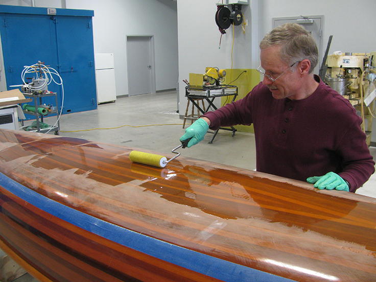 Fill layers applied to the bottom of the wood strip canoe