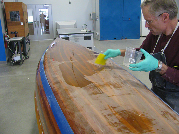 Wood strip canoe: After sanding Tom refills the low spots